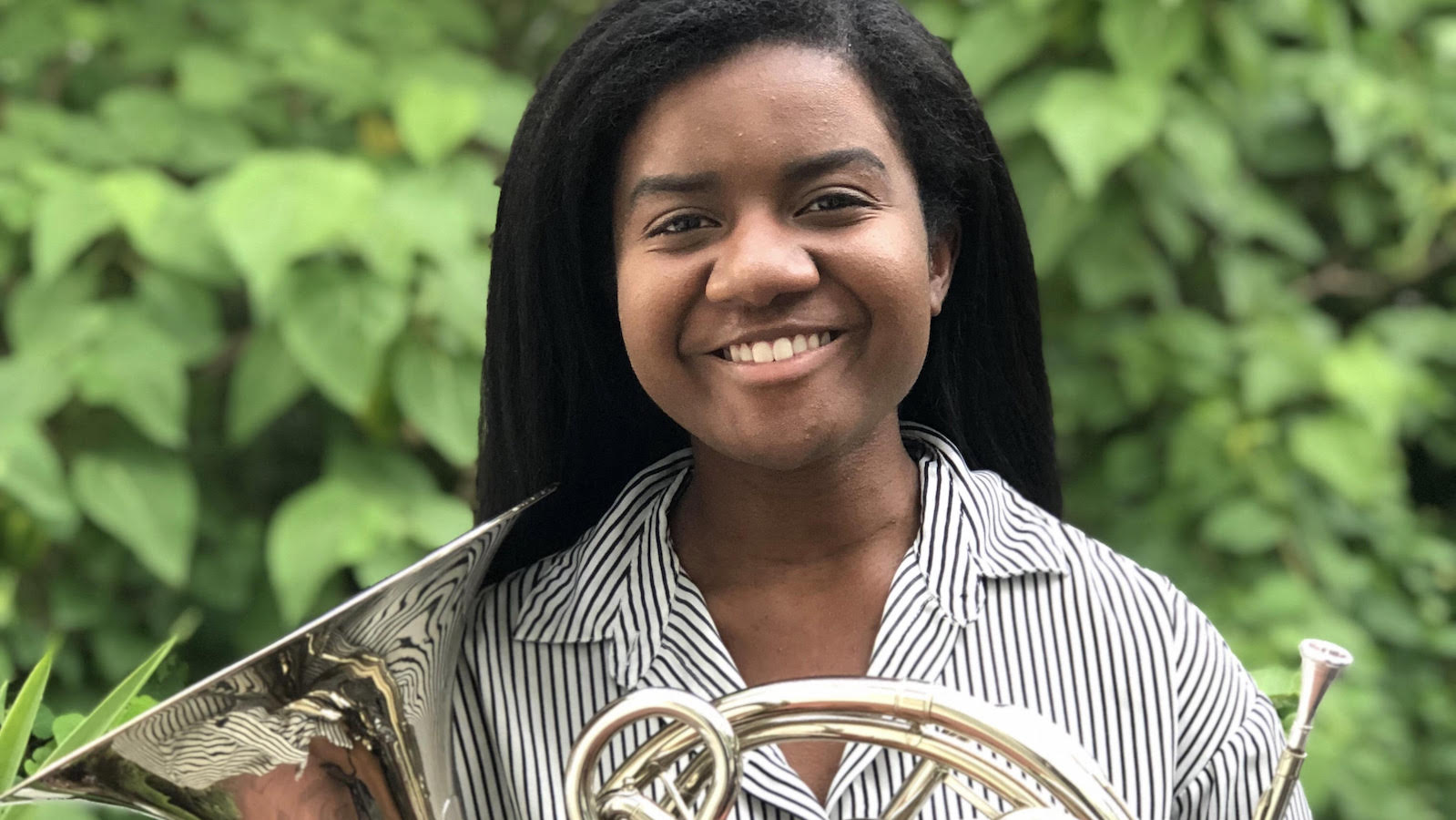 Christen Holmes holding her french horn