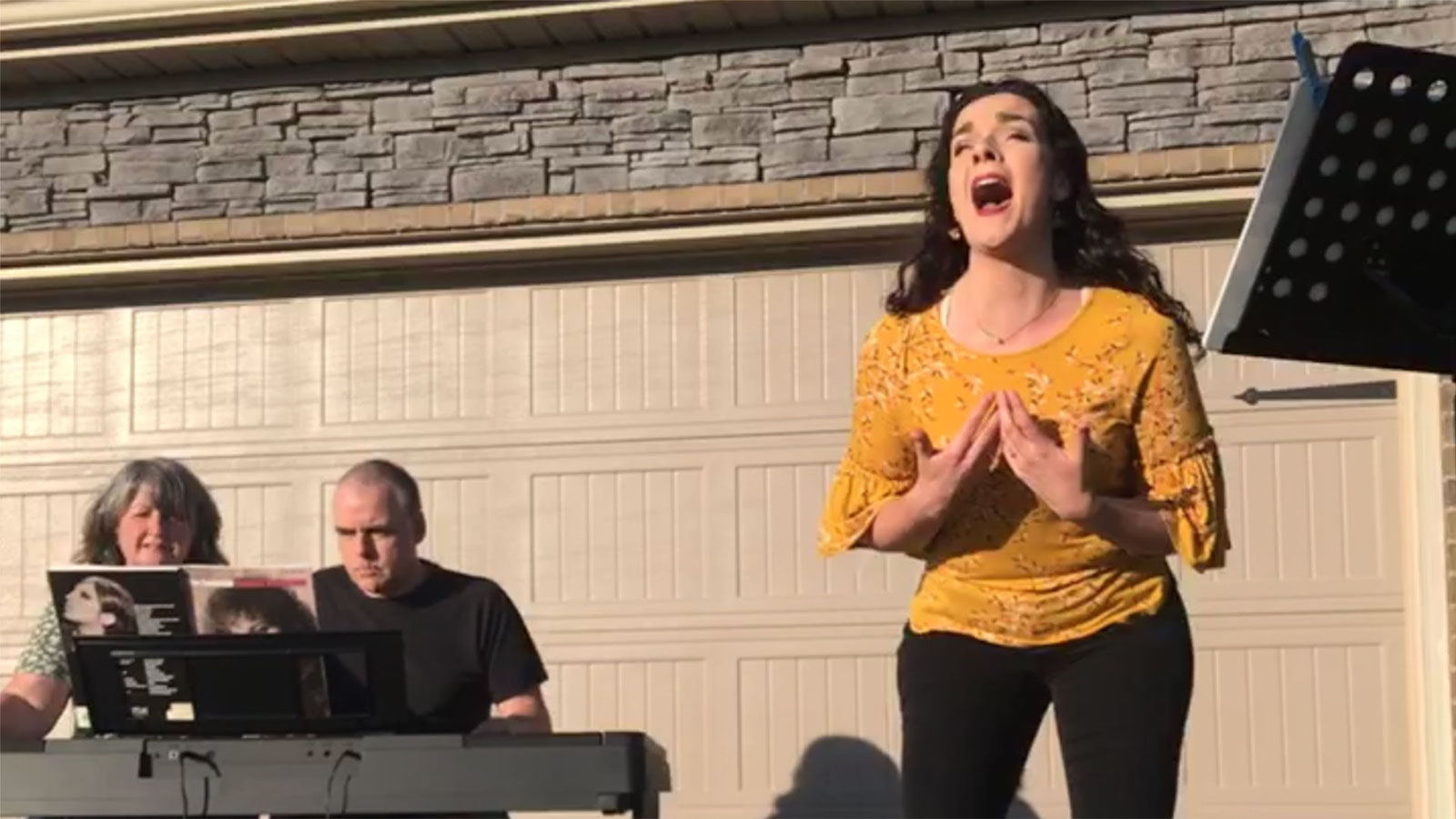 Esther Atkinson sings for her neighbors.
