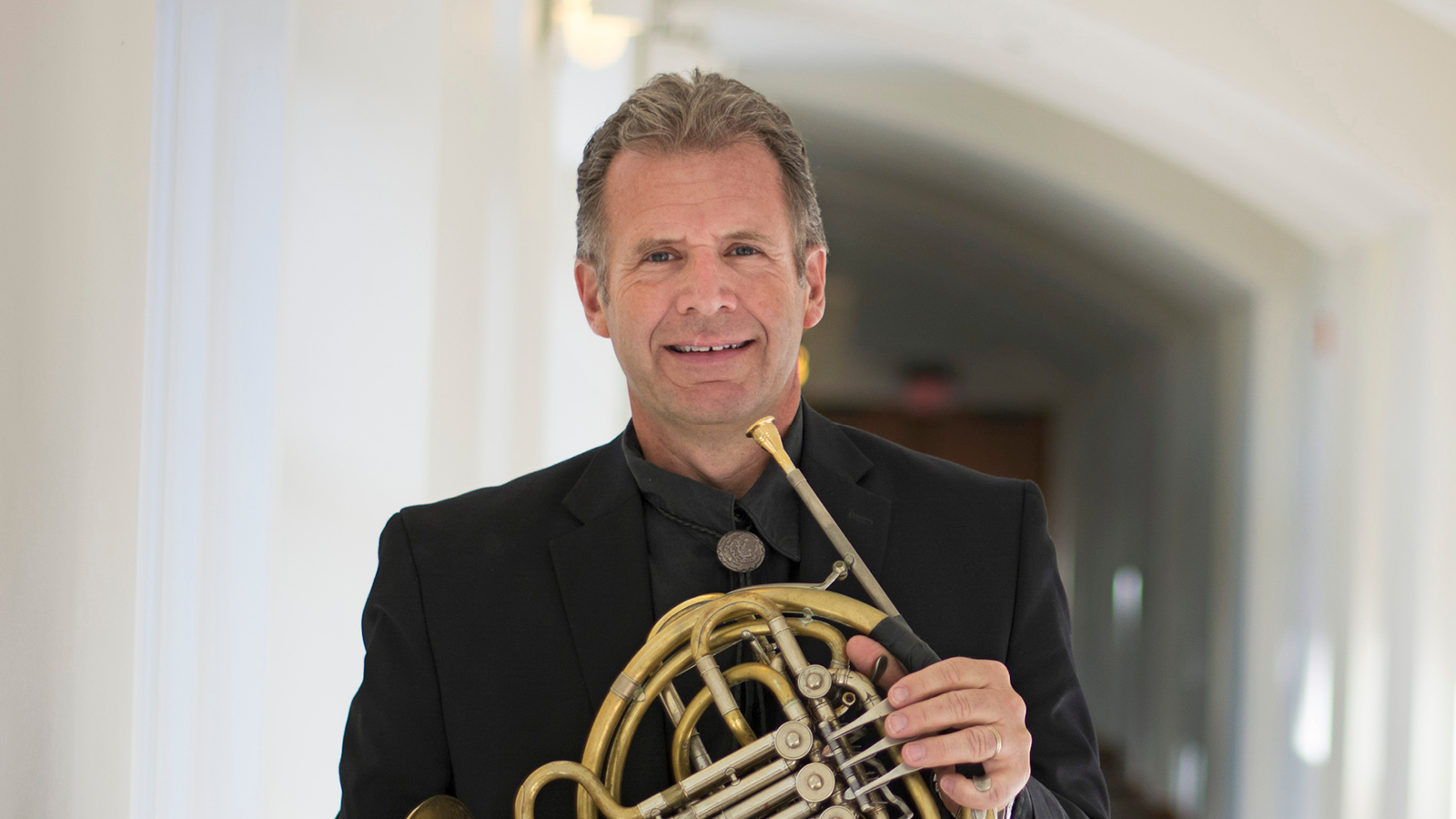 Director Gregory Miller with his horn.