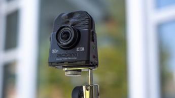 The Zoom Q2N-4K video recorder on a tripod stand.