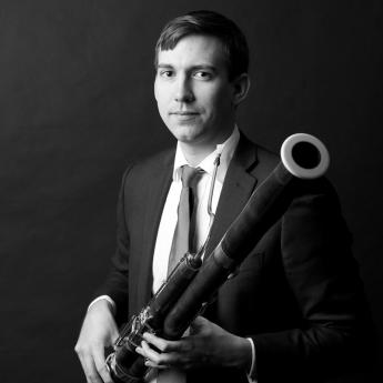 Joseph Grimmer holding his bassoon.