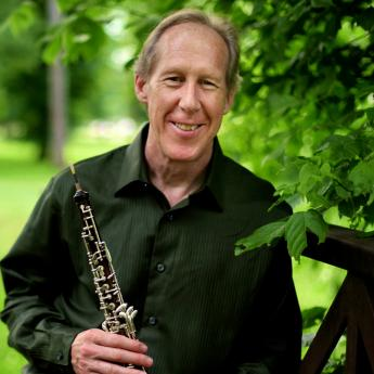 Mark Hill holding his oboe.
